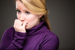 Fear/anxiety/regret/uncertainty in a young woman - effects of a difficult life situation - vivid emotions concept