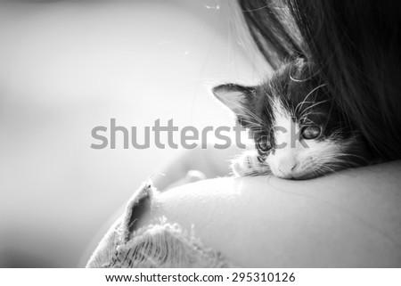 Fearful kitten was comforting by a woman on her shoulder, Vintage Style, Soft & Dreamy Effect, Low Clarity, black&white