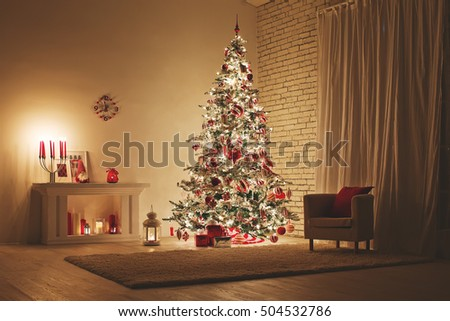 Feast of Christmas. Beautifully decorated house with a Christmas tree ipodarkami underneath #504532786