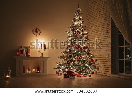 Feast of Christmas. Beautifully decorated house with a Christmas tree ipodarkami underneath #504532837