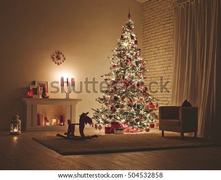 Feast of Christmas. Beautifully decorated house with a Christmas tree ipodarkami underneath #504532858