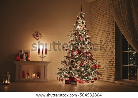 Feast of Christmas. Beautifully decorated house with a Christmas tree ipodarkami underneath #504532864