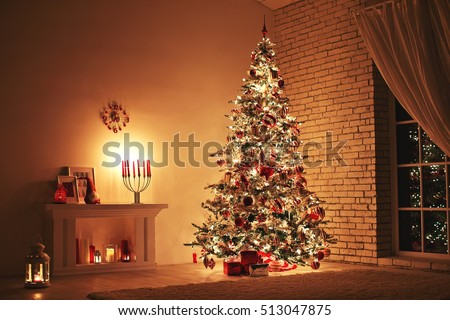 Feast of the Nativity. Beautifully decorated house with a tree and presents at Christmas #513047875
