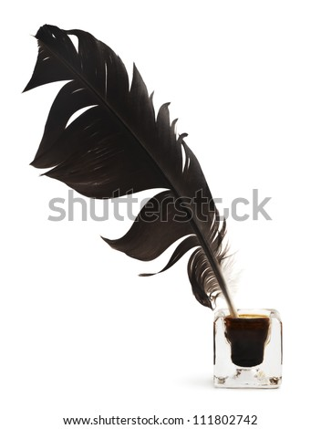 Feather and ink bottle isolated