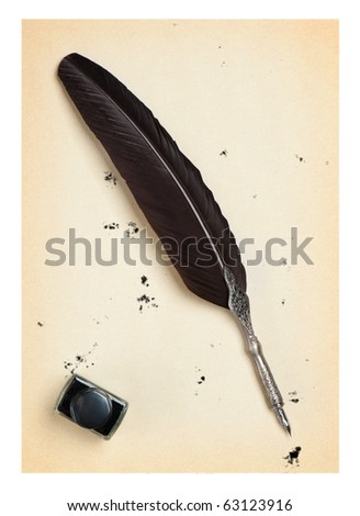 Feather quill and inkwell on an old paper. Isolated on white.Drops of the sprayed ink