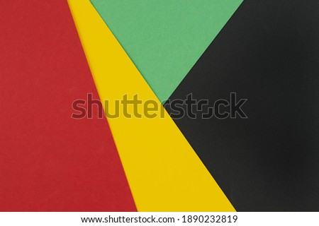 February Black History Month. Abstract Paper geometric black, red, yellow, green background. Copy space, place for your text. Top view.