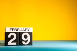February 29th. Day 29 of february month, calendar on yellow background. Winter time, leap-year. Empty space for text