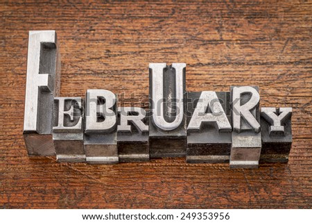 February word in mixed vintage metal type printing blocks over grunge wood