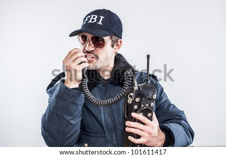 Federal agent calling it in for back up on vintage radio during an emergency going down