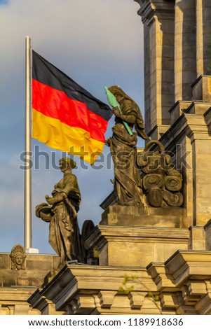 Federal Republic of Germany, German national flag at the Parliament building waving on the blue sky background