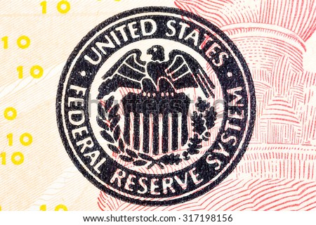 Federal Reserve icon on a ted dollar bill.