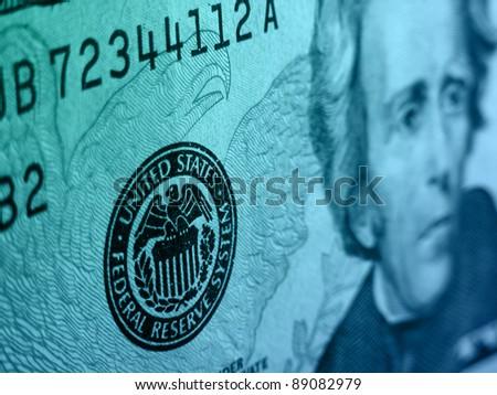Federal reserve system symbol on the twenty dollar bill.