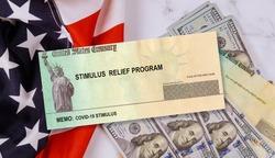 Federal STIMULUS RELIEF PROGRAM individual checks virus economic stimulus plan USA dollar cash banknote on American flag Global pandemic Covid 19 US lockdown