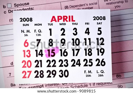 Federal Tax Form Below a Calendar-April, 2008. (DOF) Focus is on the calendar page.