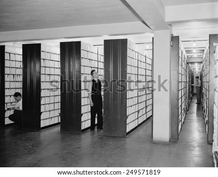 Federal workers in the patent office file room, where patents are kept on file for public use. Feb. 29, 1940.
