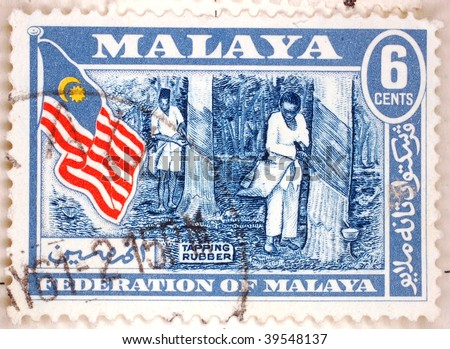 FEDERATION OF MALAYA - CIRCA 1961: A stamp printed in the Federation of Malaya shows image of the Malaysian flag, series, circa 1961