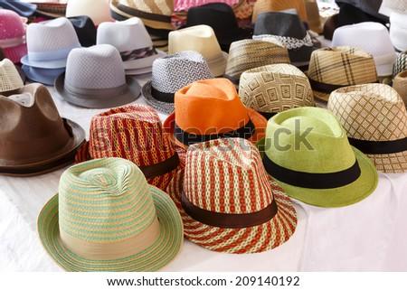 Fedora hat display at an outdoor market
