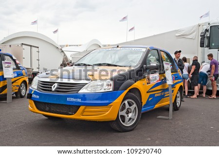 FEDYUKOVO, RUSSIA - JULY 15: Renault Logan rally car from E2 Motorsport team is displayed in the paddock of Moscow Raceway circuit on July 15, 2012 in Fedyukovo, Russia.