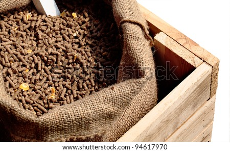 Feed pellets for farm animal in yarn sack and wooden box