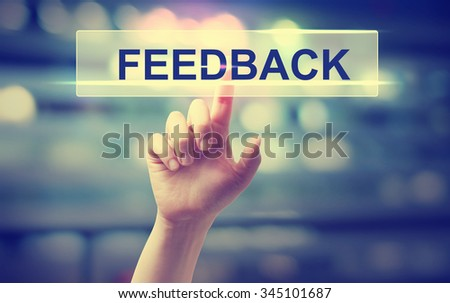 Feedback concept with hand pressing a button on blurred abstract background  #345101687