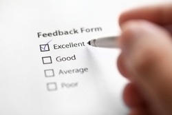 feedback form filled with satisfaction.  Quality control concept.
