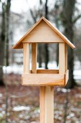 Feeder for birds in winter city park.