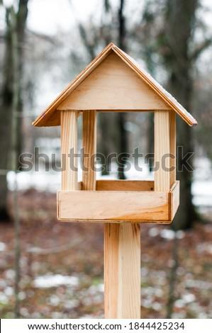 Feeder for birds in winter city park. ストックフォト ©