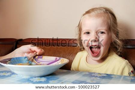 Feeding a naughty little girl