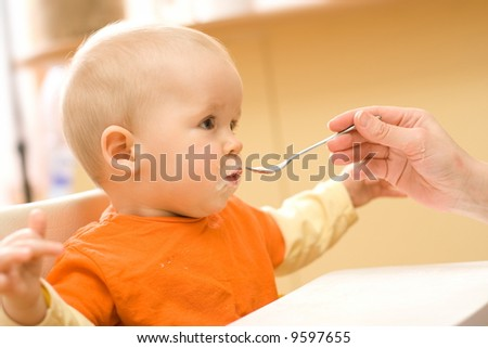 Feeding procedure of a little baby boy