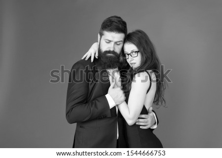 Feel rhythm of heart. Happy together. Man in tuxedo and woman black dress dancing at party. Passionate couple dancing. Lets dance tonight. Elegant couple in love tender hug dancing red background. #1544666753