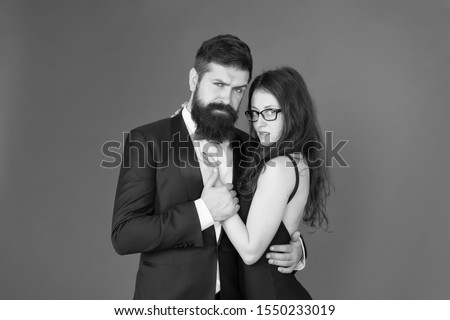 Feel rhythm of heart. Lets dance tonight. Elegant couple in love tender hug dancing red background. Happy together. Man in tuxedo and woman black dress dancing at party. Passionate couple dancing. #1550233019