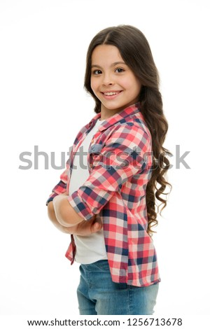 Feel so confident with new hairstyle. Kid girl long curly hair posing confidently. Girl curly hairstyle smiling face feels confident. Child hold hands confidently crossed chest. Upbringing confidence.