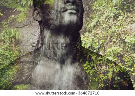 Feel the nature. Digitally composed close-up picture of shirtless young African man over the picture of waterfall