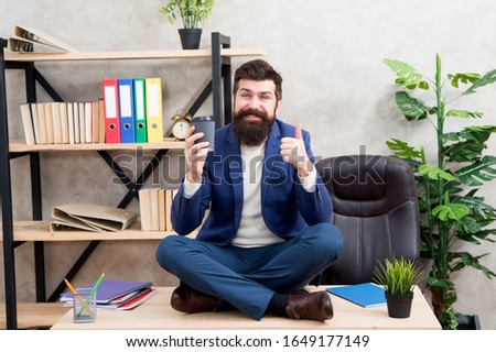 Feeling free. Way to relax. Meditation yoga. Self care. Relaxation techniques. Mental wellbeing and relax. Man bearded manager formal suit sit lotus pose relaxing. Prevent professional burnout.
