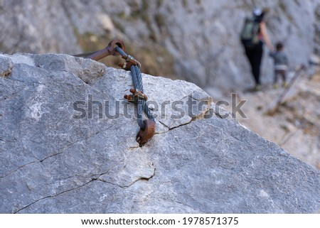 Feeling free when alone atop of a mountain. A fearless adventure that shows strength, courage and tenacity. A male and a boy hiking and climbing a wall. Success after a difficult and active climb up. Stock photo ©