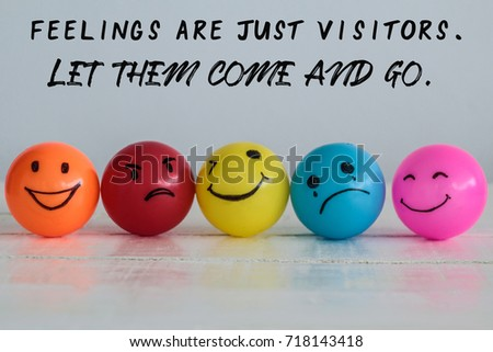 Feelings are just visitors, let them come and go, wording on background with emotional balls : smiley face ball in yellow orange and pink, sad ball in blue and madness ball in red.  #718143418