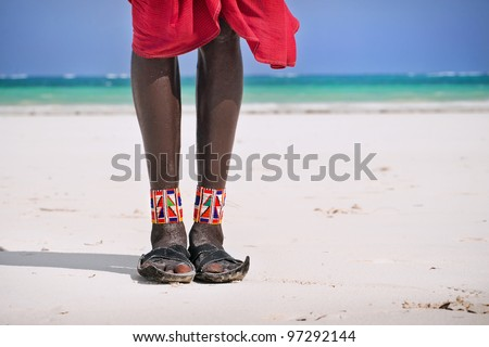 Feet and shoes Maasai on the beach