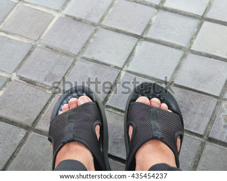2b6c00b35230d Feet and shoes. Selfie image taken from above.  435454237