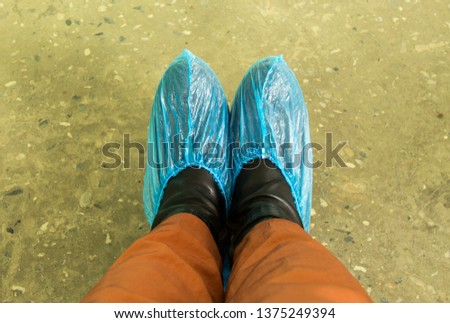 feet blue Shoe covers in the hospital the patient. Cleanliness in the clinic #1375249394
