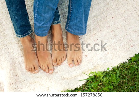 feet crossing.daylight - stock photo