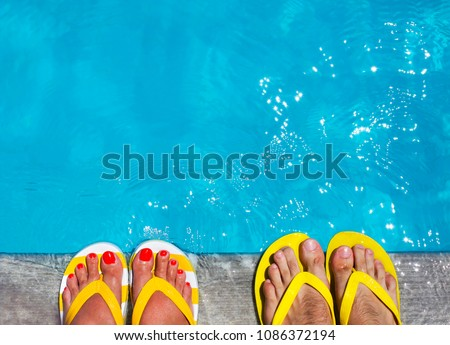 ae56714dd Feet in flip flops on stone background on poolside. Summer family vacation  concept  1086372194