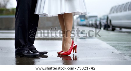 Feet in footwear of the groom and the bride