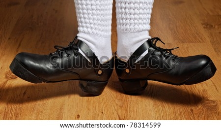 feet in irish dancing step shoes and white socks on parquet
