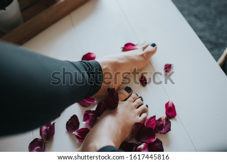 feet in red rose petals