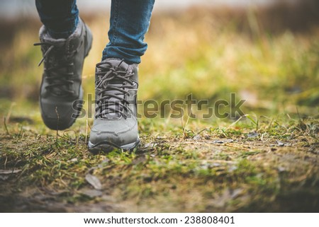 feet in shoes on a forest path #238808401