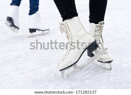 Feet in skates on ice