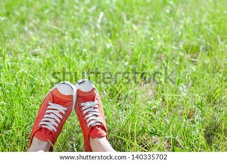 Feet in sneakers on green grass  #140335702