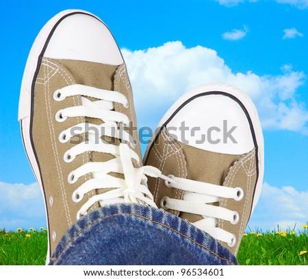 feet in sneakers on the meadow #96534601