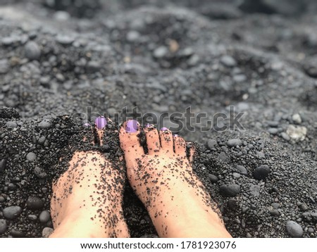 Feet in the Black Sand