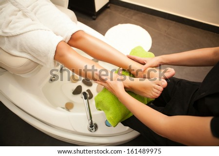 Feet massage during spa treatment